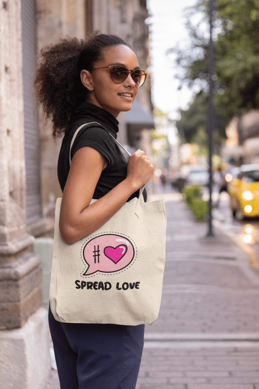 Black model modeling Spread Love Tote Bag in the city